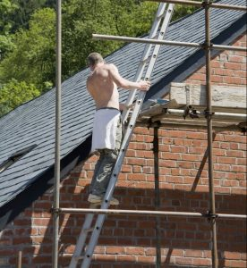 Man working on a new roof in worcester worcestershire