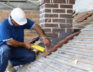 man working to repair a chimney in Worcester - chimney repair worcester worcestershire